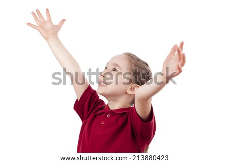 happy smiling child arms raised with joy and happiness - stock photo