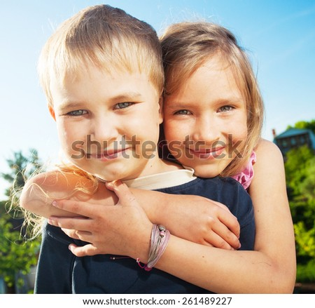 Happy smiling children at summer. Family outdoors - stock photo