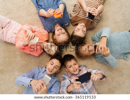 happy smiling children lying on floor in circle - stock photo