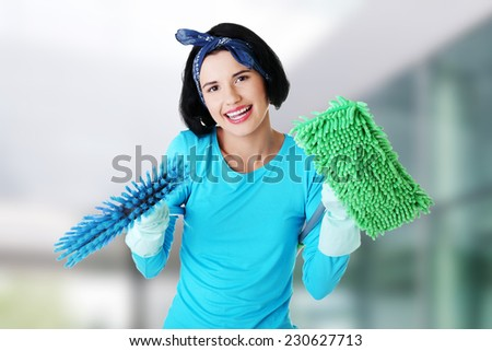 Happy smiling cleaning woman portrait - stock photo