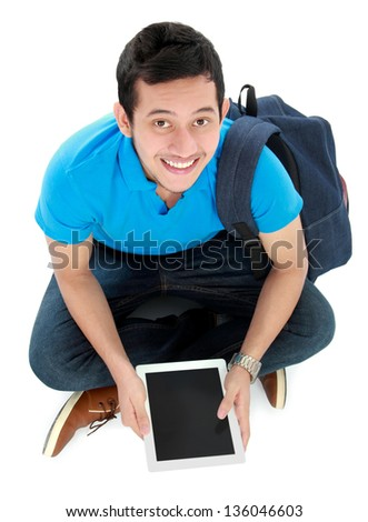 Happy smiling college student sit on the floor with tablet pc - stock photo
