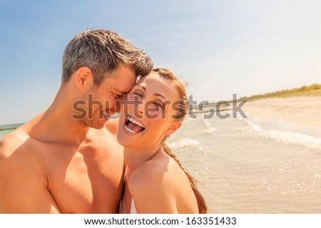 happy smiling couple enjoying warm weather - stock photo