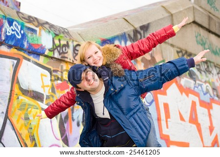 Happy smiling couple fly - stock photo