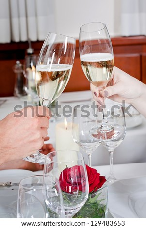 happy smiling couple in restaurant celebrate toast champagne dinner - stock photo