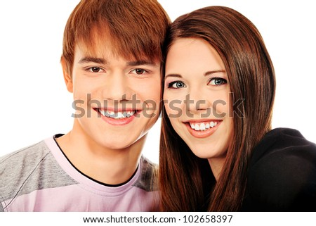 Happy smiling couple posing together. Isolated over white background. - stock photo