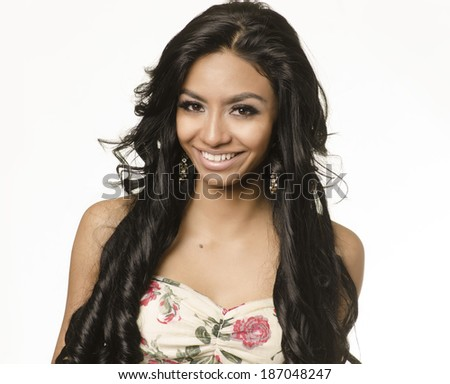 Happy smiling exotic young woman with long dark hair isolated against white - stock photo