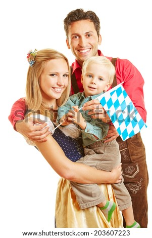 Happy smiling family in Germany with son and bavarian flag - stock photo