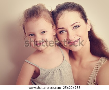 Happy smiling family. Mother and daughter. Instagram effect portrait. Closeup - stock photo