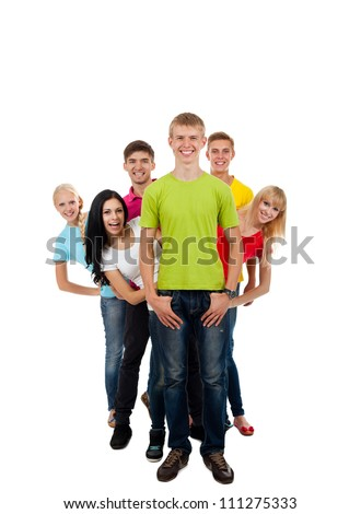 Happy smiling friends, group of young people standing in row full length portrait isolated on white background - stock photo