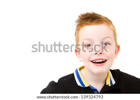 happy smiling ginger haired boy with big bright smile - stock photo