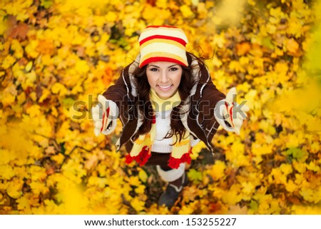Happy smiling girl in autumn park, top view - stock photo