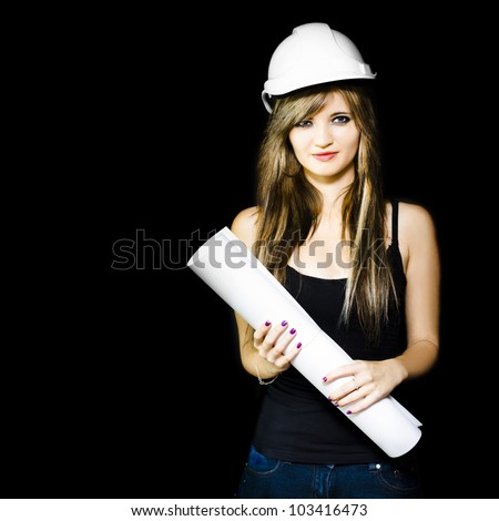 Happy smiling graduate engineer in hardhat holding construction design plans in a property development and housing construction conceptual on dark background - stock photo