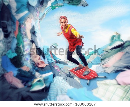 Happy smiling housewife surfing on ironing-board - stock photo