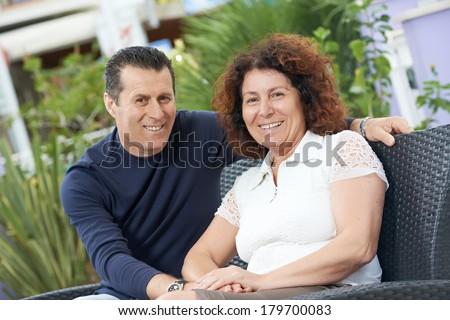 Happy smiling italian adult people couple outdoors - stock photo