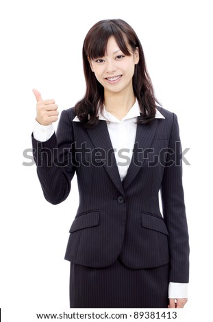 Happy smiling japanese business woman with thumbs up gesture - stock photo