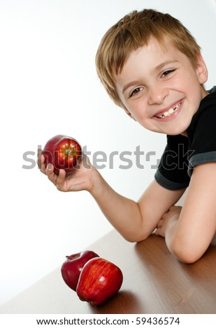 Happy Smiling Kid Holding Delicious Red Apple - stock photo