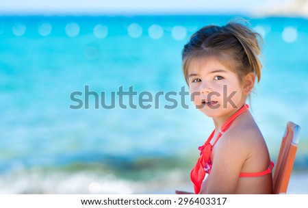 Happy smiling little girl at sea, tropical sea background. - stock photo