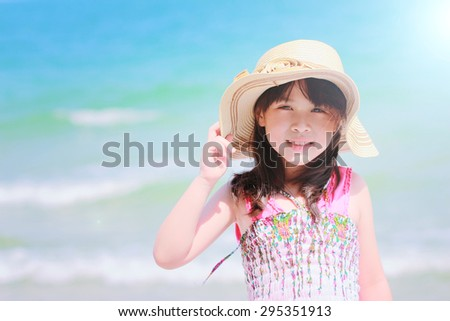 Happy Smiling little girl on beach - stock photo