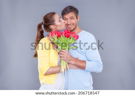 happy smiling lovely pair of younger parents - stock photo