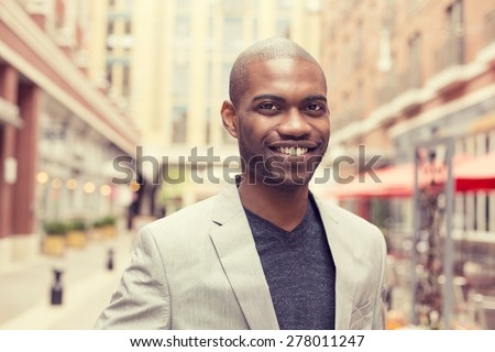 Happy smiling man outdoors  - stock photo
