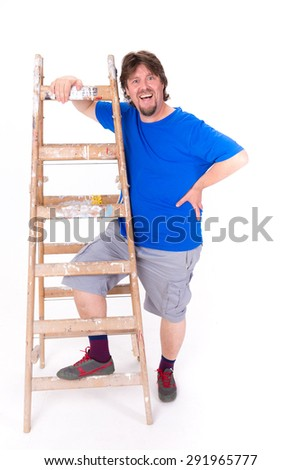 Happy smiling man standing next to a ladder isolated on a white background - stock photo