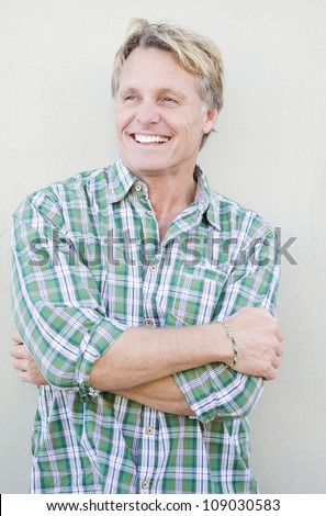 happy smiling mature man in forties with blond hair and blue eyes. - stock photo