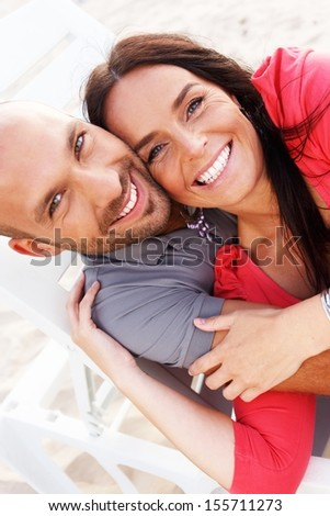 Happy smiling middle-aged couple on a beach - stock photo