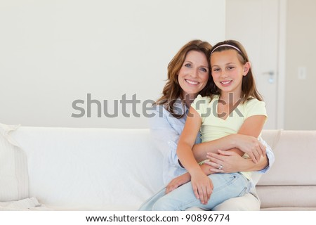 Happy smiling mother and daughter embracing - stock photo