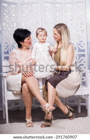 Happy smiling mother, daughter and granny - stock photo
