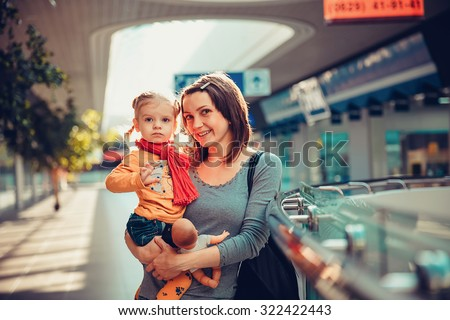 Happy smiling mother with her daughter in the shopping mall.  - stock photo