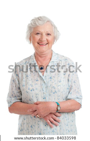 Happy smiling retired senior woman looking at camera isolated on white background - stock photo