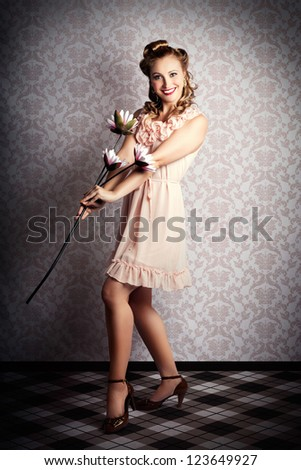 Happy Smiling 50s Bride Holding Flower Against Vintage Interior Wallpaper During A Wedding Photoshoot - stock photo