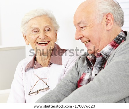 Happy smiling senior couple in a retirement home - stock photo