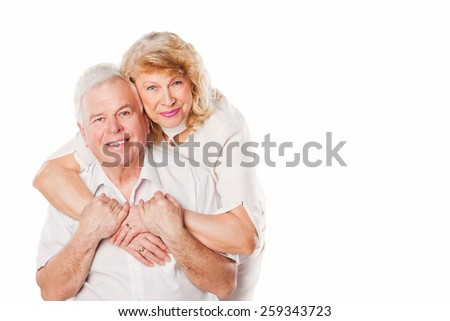 Happy smiling senior couple in love. Isolated on white background. Studio shoot - stock photo