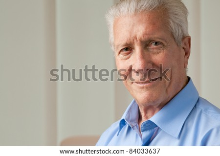 Happy smiling senior man looking at camera with satisfaction, copy space - stock photo