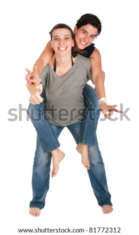 happy smiling sisters showing victory hand sign while playing together piggyback, isolated on white background - stock photo