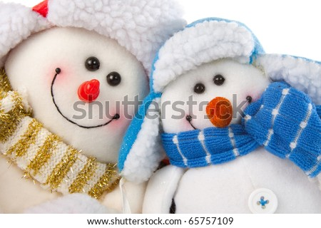 Happy smiling snowman couple. Isolated on white - stock photo