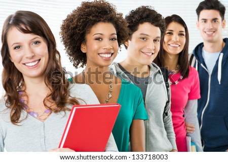 Happy Smiling Students Standing In Row - stock photo