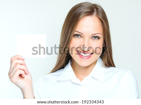 happy smiling successful business woman holding blank credit visit card. beautiful woman. - stock photo