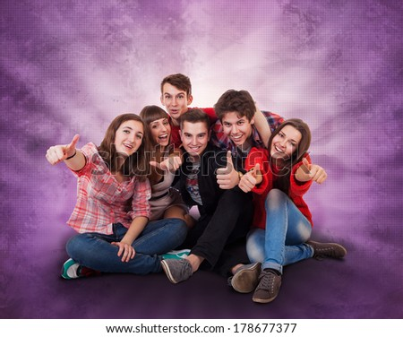 Happy smiling tenagers group on bright background - stock photo