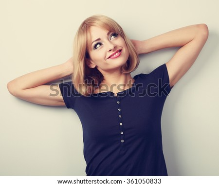 Happy smiling thinking young casual woman relaxing and looking up. Toned closeup portrait - stock photo