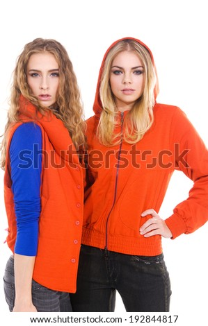 Happy smiling two young casual woman in blue jeans - stock photo