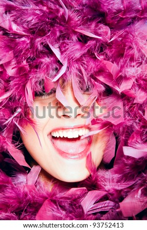 happy smiling woman in pink feathers portrait, studio shot - stock photo