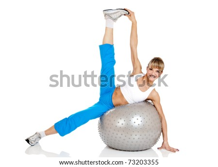 happy smiling woman in sportswear, doing fitness exercise with fit ball - stock photo