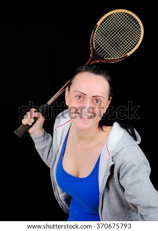 Happy, smiling woman playing squash. - stock photo