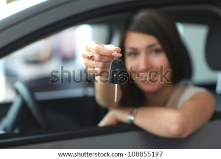 Happy smiling woman with car key. Driving - stock photo