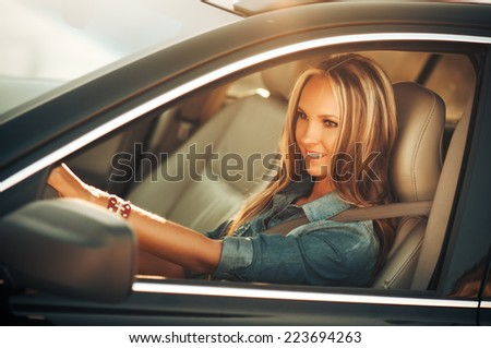 Happy smiling woman with car key. Driving. - stock photo