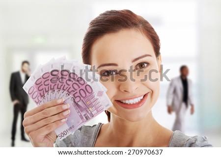 Happy smiling woman with euro money. - stock photo