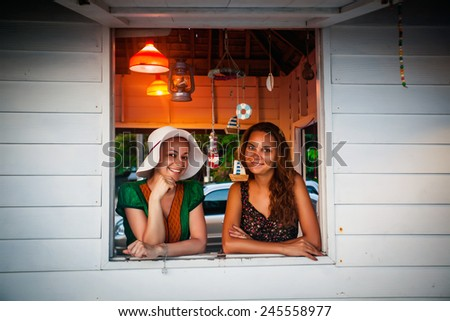 happy smiling women looking out of the window - stock photo