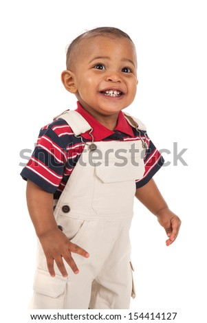 Happy Smiling 1-year old african american baby boy standing with mouth open talking - stock photo